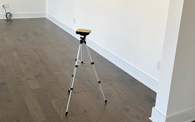 A small device about the size of a portable disc player sits on a small tripod